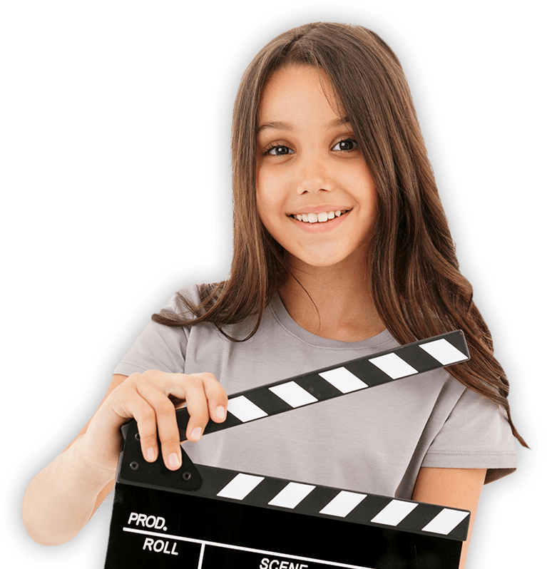 Child holding movie clap board