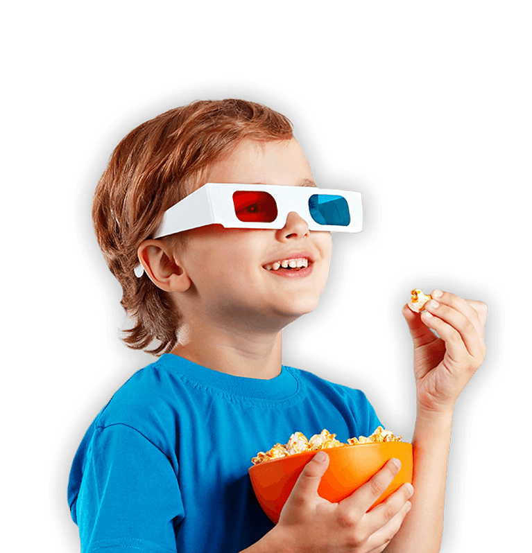 Child with 3D glasses eating popcorn