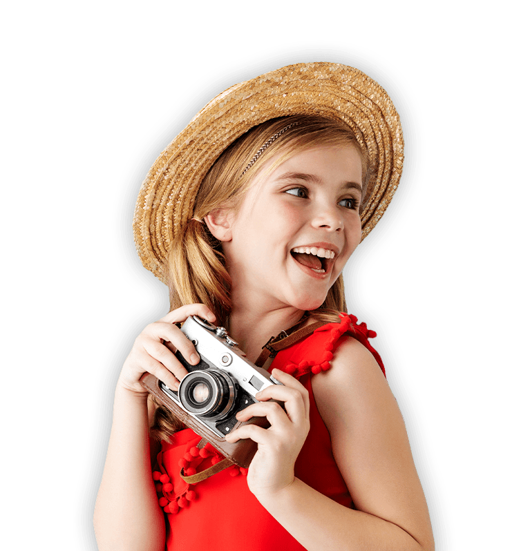 Laughing girl holding a camera