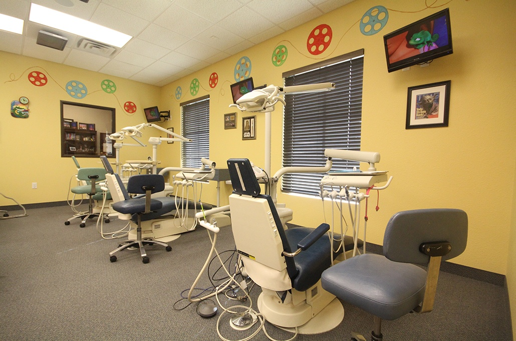 Room with three dental treatment chairs