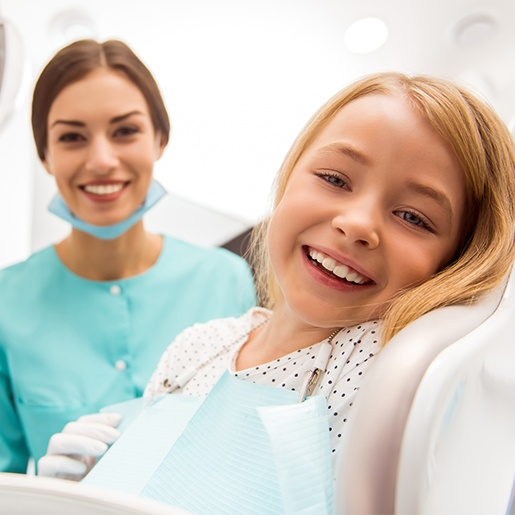 Laughing child in dental chair