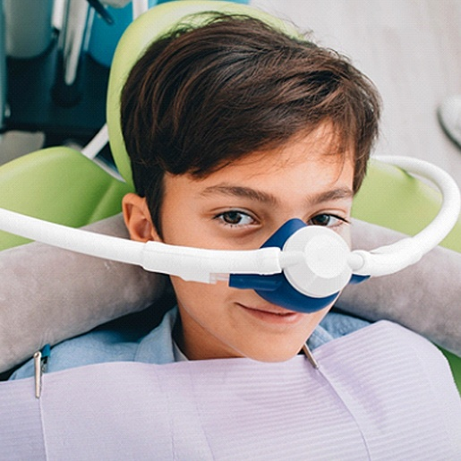 A young boy wears a nose mask in preparation to receive nitrous oxide sedation