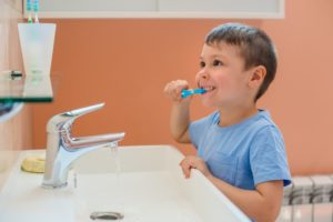child brushing his teeth during cold and flu season in aledo
