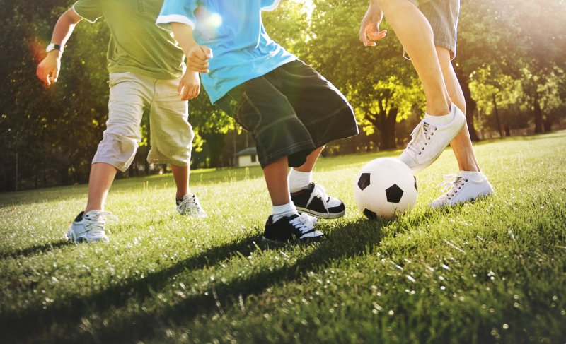 children playing sports outdoors